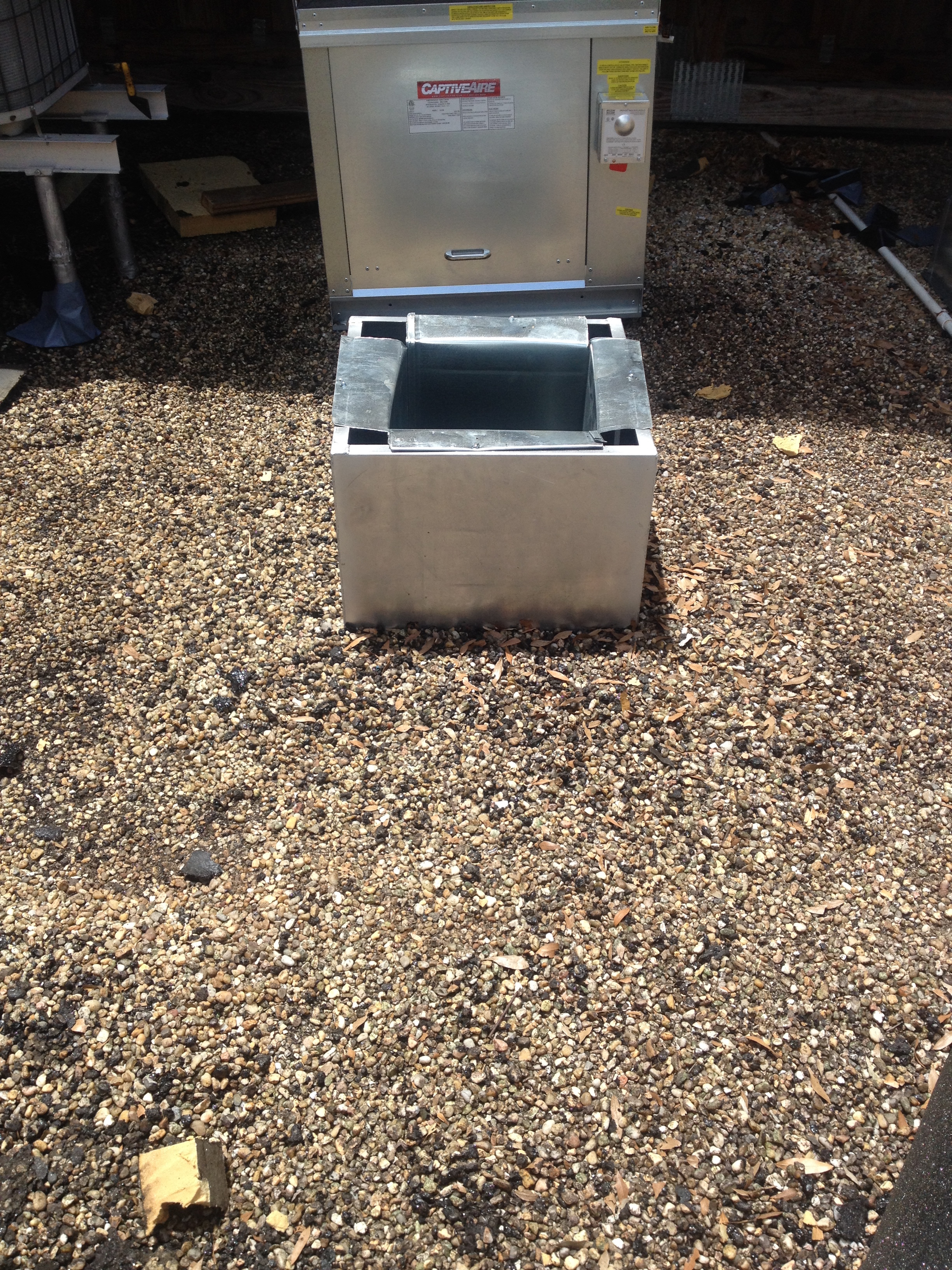 Air Vent Handlers Installed On A Tar And Gravel Roof