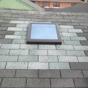 Finished Skylight Installation. This Roof Could Use a Cleaning . Notice Color Difference Between Old and New Shingles