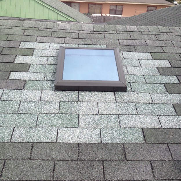 Finished Skylight Installation , This Roof Needs to Be Cleaned - Notice color Difference Between Old and New